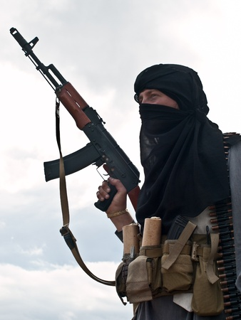 Muslim rebel with rifle photo