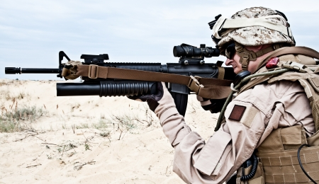 american soldier: US marine in the desert through the military operation
