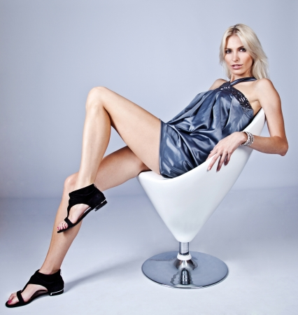 tantalising: beautiful blonde woman sitting on the chair