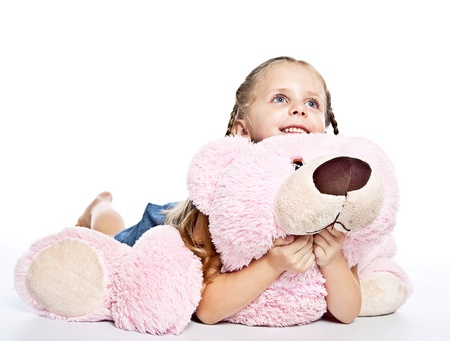 plushie: pretty little girl with plushies on white background Stock Photo