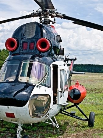 heli: Modern light  helicopter standing on a field Stock Photo