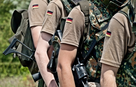 armed services: squad of german soldiers holding machine guns Stock Photo