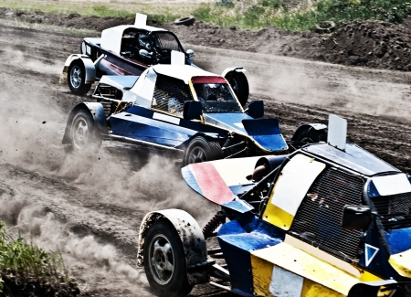 three extreme offroad motor cars on a quick start photo