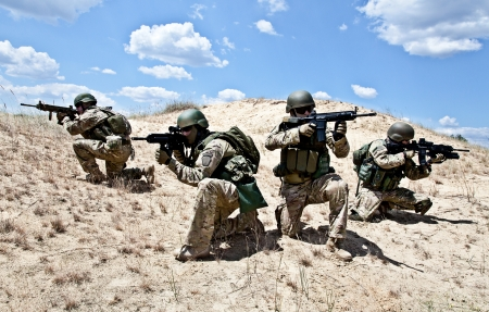 army: Squad of soldiers in the desert during the military operation