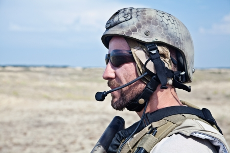Bearded SEAL team member in the desert photo