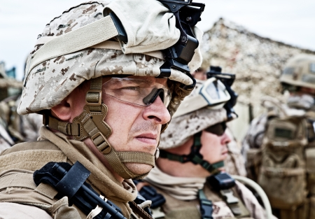 military uniform: US marine in the MARPAT uniform and protective military eyewear
