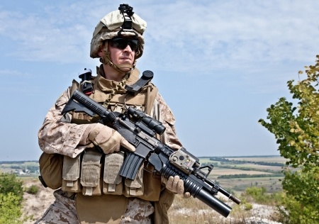 american soldier: Close-up photo of US marine with his rifle