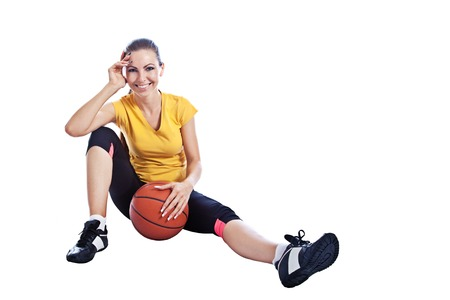 athletic wear: Isolated young beautiful girl in athletic wear with basketball
