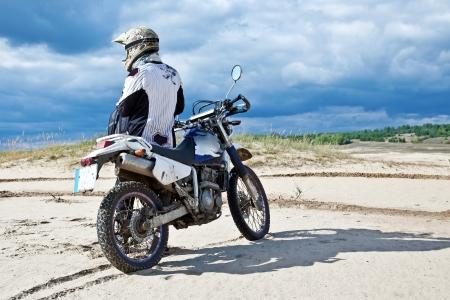 mx: Enduro bike rider driving across the desert