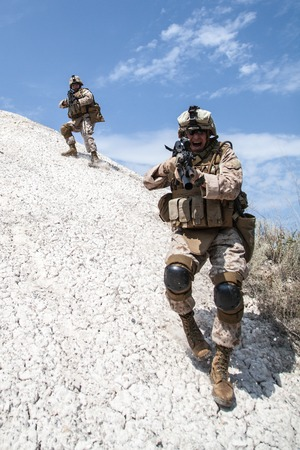 nato: Two soldiers in the mountains during the military operation