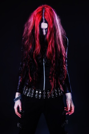 Young goth girl with a red hair photo