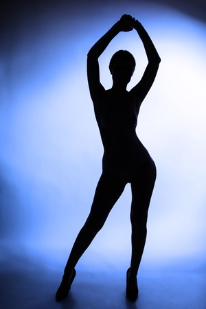 Erotic silhouette of nude and sexy woman photo