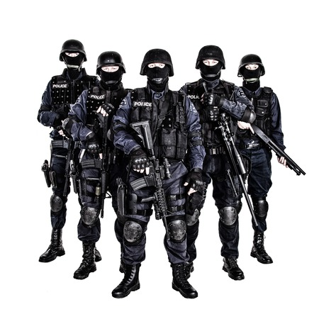 Special weapons and tactics (SWAT) team officers with guns