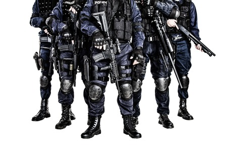 counterterrorism: Special weapons and tactics (SWAT) team officers with guns