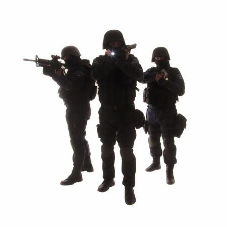 counterterrorism: Silhouettes of special weapons and tactics (SWAT) team in action