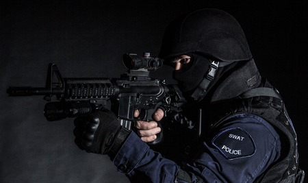 counterterrorism: Special weapons and tactics (SWAT) team officer on black  Stock Photo
