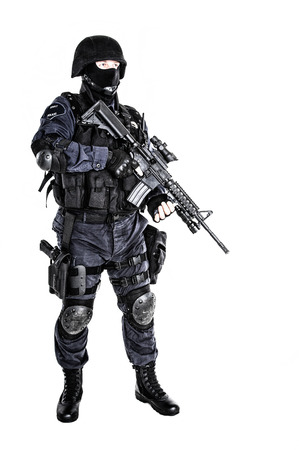 counterterrorism: Special weapons and tactics (SWAT) team officer with his gun