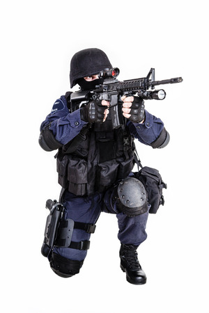 Special weapons and tactics (SWAT) team officer with his gun