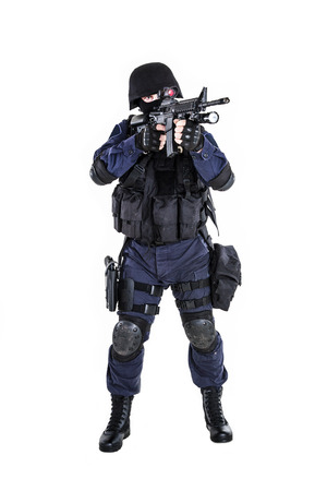 swat teams: Special weapons and tactics (SWAT) team officer with his gun
