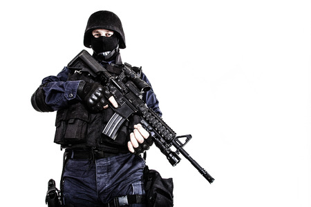 anti war: Special weapons and tactics (SWAT) team officer with his gun