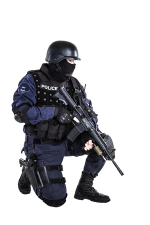 squad: Special weapons and tactics (SWAT) team officer with his gun