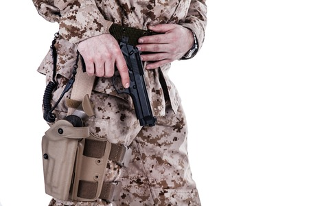holster: US marine extracting his pistol from a holster