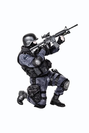 security vest: Special weapons and tactics SWAT team officer with his gun