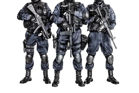 Special weapons and tactics SWAT team officers with guns photo