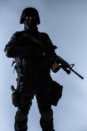 Special weapons and tactics team SWAT officer silhouette Stok Fotoğraf