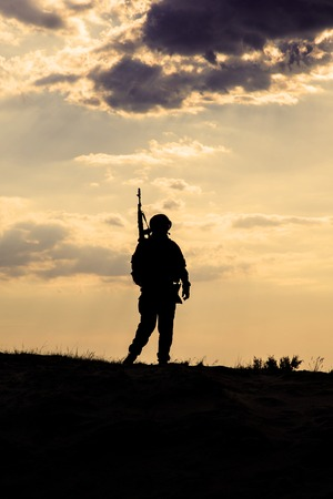 sergeant: Silhouette of US soldier with rifle  against the sunset Stock Photo