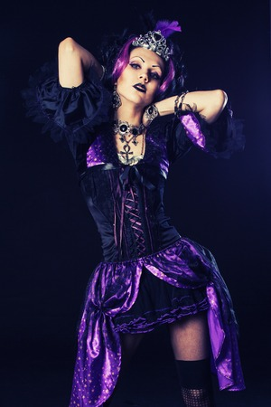 Young goth girl dressing a weird clothes in violet tones photo