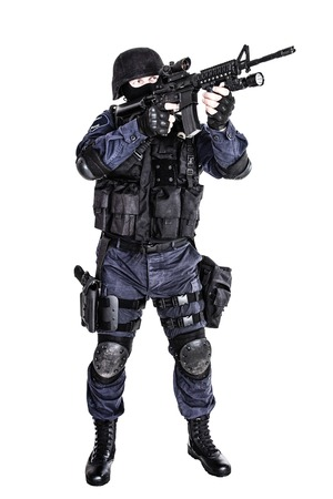 assault forces: Special weapons and tactics SWAT team officer with his gun