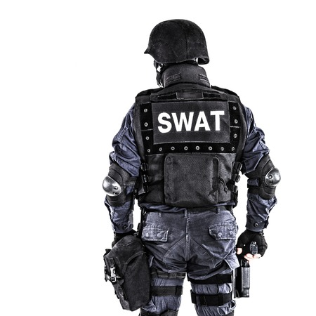 counterterrorism: Special weapons and tactics SWAT team officer shot from behind