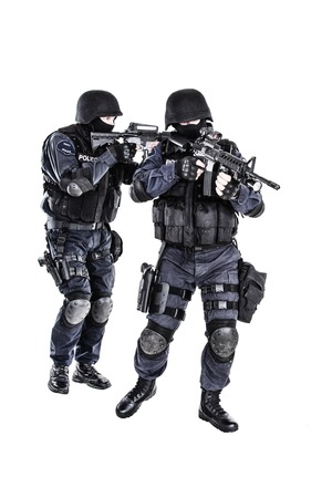 swat teams: Special weapons and tactics SWAT team in action Stock Photo