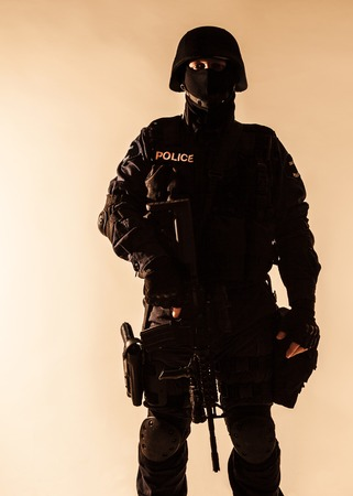swat teams: Special weapons and tactics team SWAT officer silhouette Stock Photo