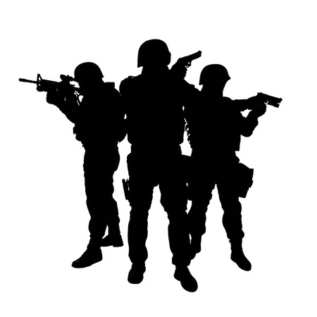 Silhouettes of special weapons and tactics SWAT team in action photo