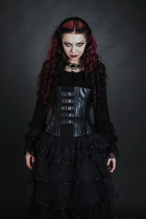 gothic girl: Young goth girl with a red hair
