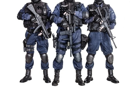 squad: Special weapons and tactics SWAT team officers with guns
