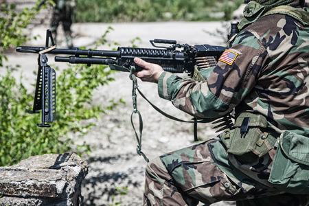 nato: NATO soldier with machine gun during the military operation