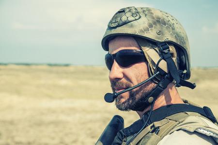 Bearded SEAL team member in the desert