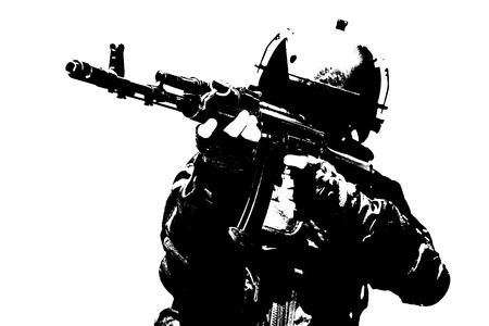 swat: Hard light image of spec ops soldier in face mask with his rifle Stock Photo