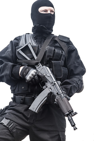 assault rifle: Spec ops soldier in black uniform and face mask with his rifle Stock Photo
