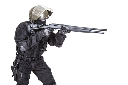 counter terrorism: Spec ops soldier in black uniform and face mask with shotgun Stock Photo
