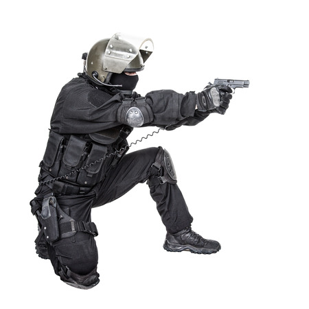 security vest: Spec ops soldier in black uniform and face mask aiming his pistol Stock Photo