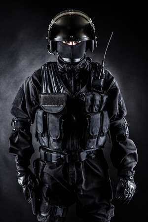 Spec ops soldier in uniform on black background