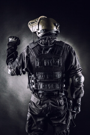 tactical: Spec ops soldier on black background shot from behind