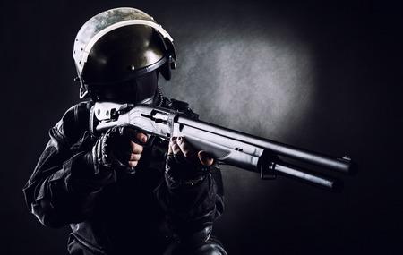 swat: Spec ops soldier on black background with shotgun Stock Photo