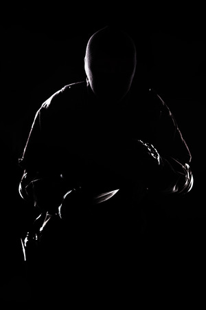 us soldier: Contour shot of spec ops soldier with knife on black background