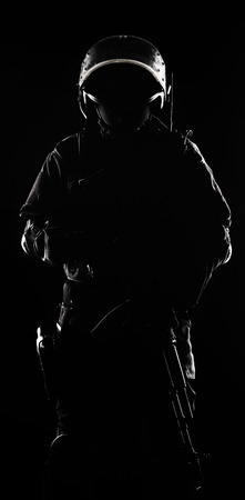 Contour shot of spec ops soldier on black background photo