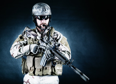 assault forces: Bearded special forces soldier on dark background Stock Photo
